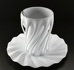 The cup designed by Yury Dovganyuk and inspired from the action of the dancers.