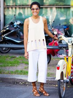 Tamu McPherson in a Stella McCartney knit top with open cut-out shapes, Cos white culottes and Miu Miu lace-up sandals. How To Wear Culottes, Culottes Outfit, Street Chic, Street Fashion, Ss16, Summer Outfits, Casual Outfits, Fashion Outfits, White Culottes