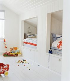 Nautical style boys room with beds built into eaves