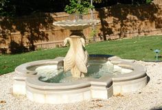 Cast Stone Fountain. Pool with coping, with a statue and fountain.