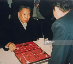 Pol Pot buying a watch for his wife in Beijing, in China, in 1988.