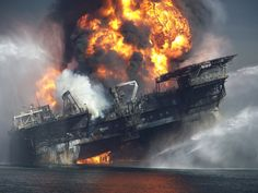 Deepwater Horizon - on fire, shortly before sinking and taking 11 lives with it. A photo originally provided anonymously to the NY Times by a worker in the gulf who took this incredible shot.