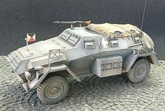 The SdKfz 247 saw a very limited production series(but so did the M26 Pershing in ww2) and was used as a transportation for staff officers and commanders on the field. The vehicle is usually unarmed(could be armed with the same old MG34) but offers almost full protection for its passangers(since in H&G the covers of trucks are bulletproof the SdKfz 247 would be almost fully enclosed but for the slit between the drivers roof and the cover)