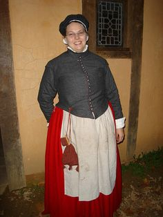 Jen Thies at Jamestown Settlement. New wool doublet with red wool petticoat, knit chatelaine set, and appropriately dirty apron. Proudly donning my knit flat cap from Heather. Both red wool petticoat and green linen petticoat bodies need hemming of at least an inch if for use at Jamestown with possible mud.