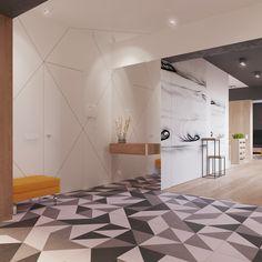 Porta d'ingresso con piastrelle geometriche in bianco e nero abbinati a grandi pannelli bianchi che rivestono le pareti