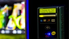 Qualcomm's break rooms got a serious technology upgrade with NFC vending machines.  Although we're still stuck with the same candy options, the new machines now accept both  credit card and smartphone payments via Near Field Communications (NFC)