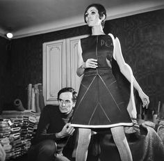 Pierre Cardin adjusting a dress on a model, photographed by François Pages, 1968