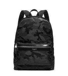 Make a cool city statement with our camouflage Kent backpack. Waterproof nylon keeps the elements at bay, while adjustable padded straps lend customized comfort. Carry it with a leather jacket and sneakers for a sleek urban air.
