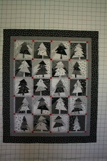Winter Pines from the book Black and White Quilts By Design by Kay Capps Cross. Cross cut technique. This author has a lot of unique designs using cross-cutting and paper piecing construction.