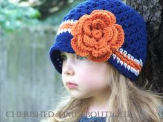 Auburn crocheted hat with flower