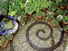 Pebble Patio with Swirl Design Small Mosaic Raised Pond, Plants in Pots, Brighton