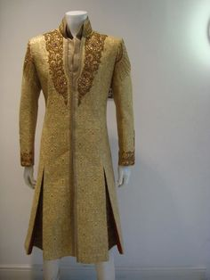 Gold Sherwani and amazing handwork. Beauty is in details. To get your own detailed outfit visit www.faaya.in:
