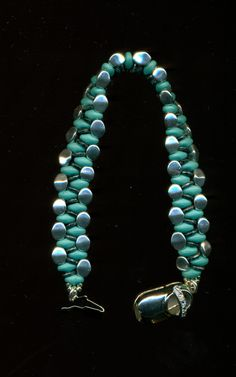 Pinch and O bead Bracelet by Marcie Lynne. Not sure, but these look like pinch and superduo beads. No link to follow.