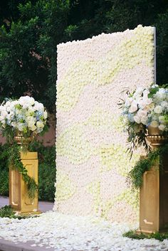 Romantic wedding ceremony floral wall at Disneyland overflowing with ivory and blush roses