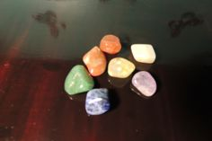 Chakra Healing Stones used in the practice of Reiki healing.