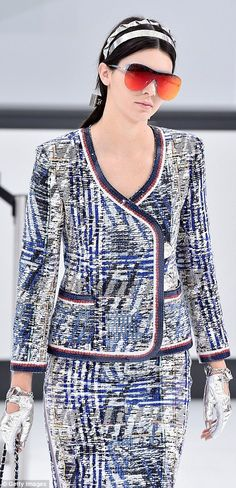 Air hostess: Kendall was decked out in a smart tweed blazer with a sequinned hem and a matching pencil skirt, teamed with silver gloves