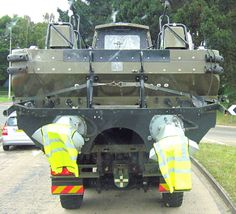 Army boat being transported on Army flatbed truck June 2014 1