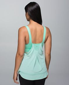 Super cute LuLuLemon tank with cute back design...also has a built-in bra!