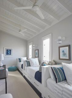 Maximize beach house space by incorporating built in beds with storage space. This creates the perfect place to entertain, play and sleep!