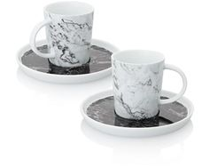 This marble cup and saucer set. | 21 Little Gifts That Will Make A House A Home