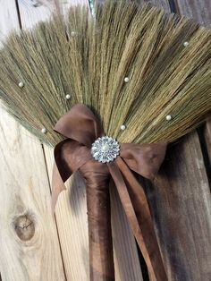 Brown Wedding broom with bow and brooch by BroomsBasketsNBrides