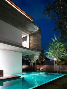 A cool house design that I would place in California with the interesting shape of the house and with the nice pool.