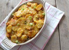 Italiaanse ovenschotel met aardappelschijfjes, Italiaanse groenten, gehakt en kruiden.