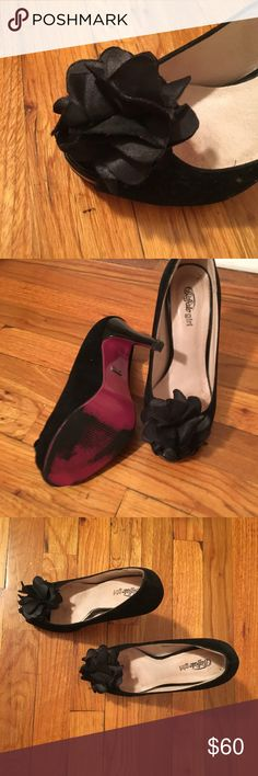 Black Velours high levels with cute detail I have worn these high heels twice-they are a little too big for me. High end quality makes them comfortable witch black velours outside, leather inside, the heel shiny black, with a pink bottom for the complete length of the bottom. Definitely getting all the attention in the room! Buffalo Shoes Heels