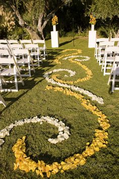 yellow and white ceremony floral runner at the parker palm springs, ca wedding.  allyson magda photography