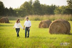 Comfortable and rustic engagement image out in the country just outside of Louisville KY.  Bales of hay are always a fun backdrop. Image by David Blair Photography