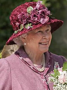 Queen Elizabeth in a maroon Easter hat.  She seems to favor shades of purple at Easter.