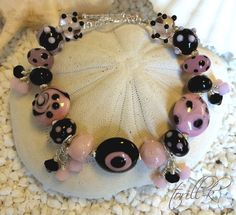 Handmade bracelet with artisan lampwork, swarovski-crystals and Sterling silver. By torill-k