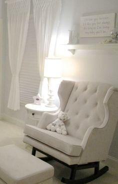 You can never go wrong with a classic all white nursery. You can add a soft baby blue or soft rose quartz colored throw to define. -KC