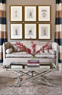 I love the set of prints framed and hung to act as one large piece of art. The coffee table is beautiful with nailheads and mirrored.