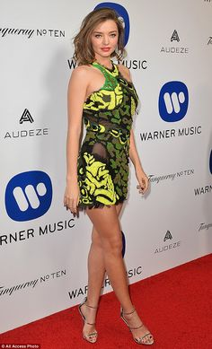 Leading the glamour:Miranda Kerr induced a fresh bout of body envy as she showcased her supermodel figure in a leg-baring ensemble at Warner Music's Grammy Awards after party on Monday evening