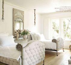 Pamela Pierce designed this elegant guest room with tufted beds via Veranda