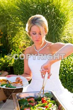 Dinner is served at this beautiful wedding reception outdoors at a vineyard.