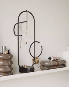 The Obu Jewellery Stand by ferm LIVING. On its base of solid, black marble the abstract metal wire is formed into a sculptural tree for your Earring Display, Jewellery Display, Jewelry Store Design, Accessories Display, Box Container, Style Deco, Jewelry Tree, Flower Jewelry, Dainty Jewelry