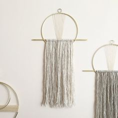 Brass 8 circle and flat vertical brass bar wall hanging with hanging yarn in pale grey, ivory/flax or tan. The brass circle is partially wrapped with hand-dyed waxed linen and attaches a small vintage brass loop for hanging. Total dimensions are 12 wide and 20 tall. The fringe extends 14-15 from the brass bar. *Each wall hanging and mobile is made to order. Please allow up to 5 business days for your order to be shipped. This listing is for one wall hanging.* I normally ship via USPS…