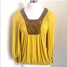 Yellow beaded blouse Beautiful beaded boho blouse! Like new - no beads are missing. Smoke-free and pet-free home. Elastic on sleeves and at the bottom. Size shows M but could easily fit L. Chelsea & Violet Tops Blouses