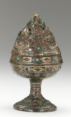 Incense burner (boshan xianglu) inlaid with gold turquoise and carnelian. Han Dynasty (206 B.C.E-220 C.E).