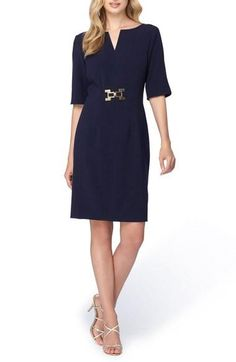 "- Gleaming metallic hardware accentuates the waistline of this sleek, stretchy sheath dress tailored with a notched neck and flattering elbow-length sleeves. - 37"" regular length (size 8); 35"" petite"