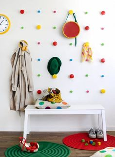 Make a colorful grid of polka dots intermingled with hangers for coats, hats and backpacks.