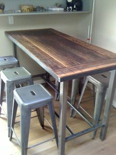 Rustic kitchen island and stools - love the wood/metal combo