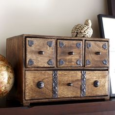 This four-drawer chest pairs perfectly with rustic decor or traditional styling. The pairing of natural wood and brushed steel knobs add charm while safely storing keepsakes.