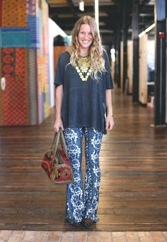 statement necklace, loose tee, fitted flared pants, and a funky bag...perfection :)