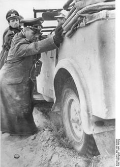 """""""The Desert Fox"""" Erwin Rommel and General Siegfried Westphal helping with pushing a stuck vehicle North Africa 1941. Photo: Bundesarchiv Bild 183-B20800 Valtingojer."""