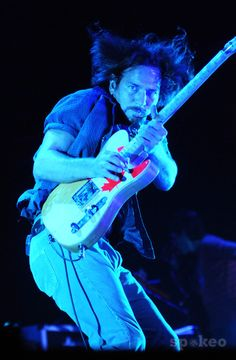 Eddie Vedder - Pearl Jam I just think this is an amazing picture of him, his intensity, those freakin eyes...