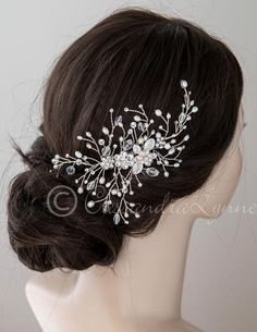 Three rhinestone floral accents are captured by sprays of ivory freshwater cultured pearls, round cut stones and elongated bicone crystal beads in this stylish