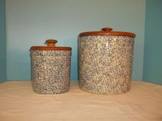 TWO, HENN POTTERY BLUE ROSEVILLE SPONGEWARE CROCKS WITH LIDS